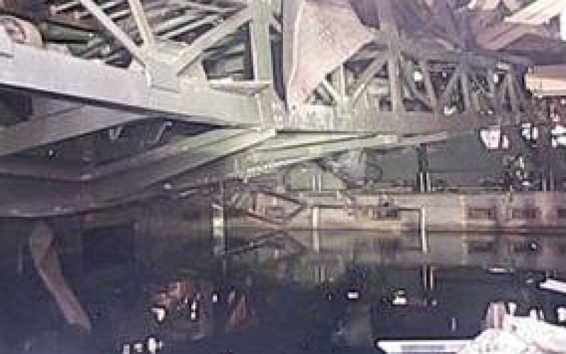Tepco released photos of Reactor 1 / Fuel handling machine barely hung just above SFP