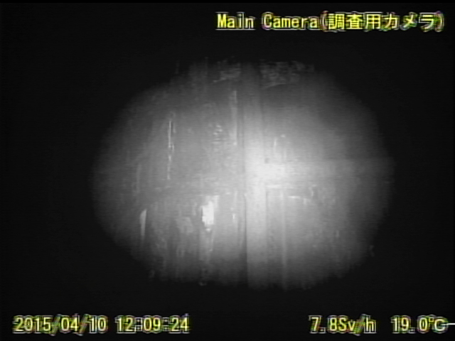 11 Video:Photo The dead robot reported 10 Sv:h in Reactor 1 : Grating covered with something like yellow glue