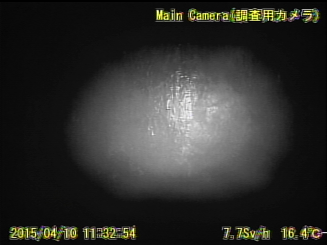 12 Video:Photo The dead robot reported 10 Sv:h in Reactor 1 : Grating covered with something like yellow glue
