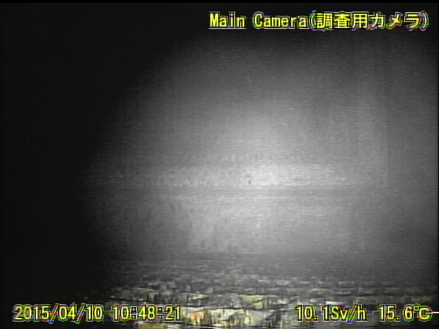 13 Video:Photo The dead robot reported 10 Sv:h in Reactor 1 : Grating covered with something like yellow glue
