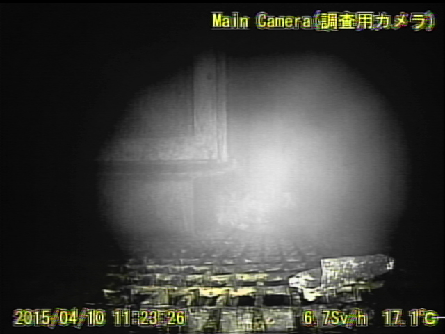 14 Video:Photo The dead robot reported 10 Sv:h in Reactor 1 : Grating covered with something like yellow glue