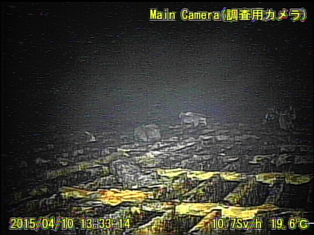 4 Video:Photo The dead robot reported 10 Sv:h in Reactor 1 : Grating covered with something like yellow glue