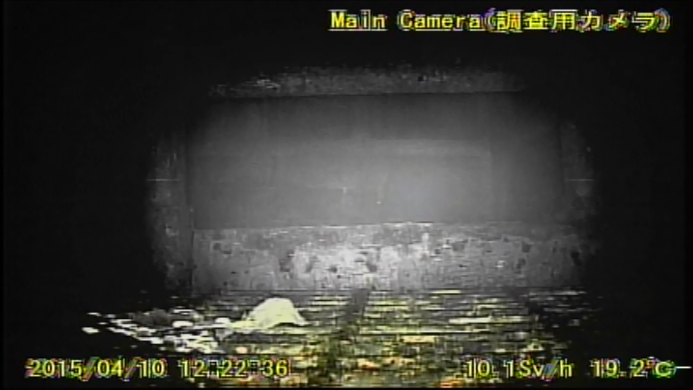 7 Video:Photo The dead robot reported 10 Sv:h in Reactor 1 : Grating covered with something like yellow glue