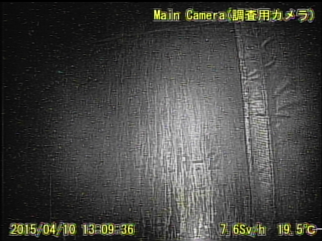 9 Video:Photo The dead robot reported 10 Sv:h in Reactor 1 : Grating covered with something like yellow glue